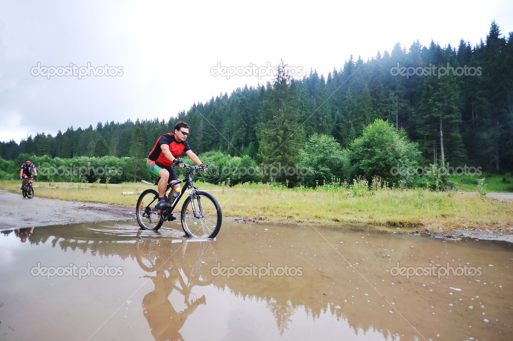 Healthy lifestyle and fitness concept with mount bike man outdoor — Stock Photo #1688823