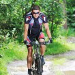 Wet mount bike ride — Stockfoto