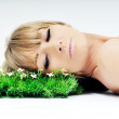 Woman face on grass - Stock Photo