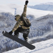 Freestyle snowboarder jump and ride — Stock Photo #2239214