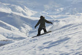 Freestyle snowboarder jump and ride — Stock Photo