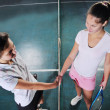 Young girls playing tennis game indoor — Stock Photo #2513298