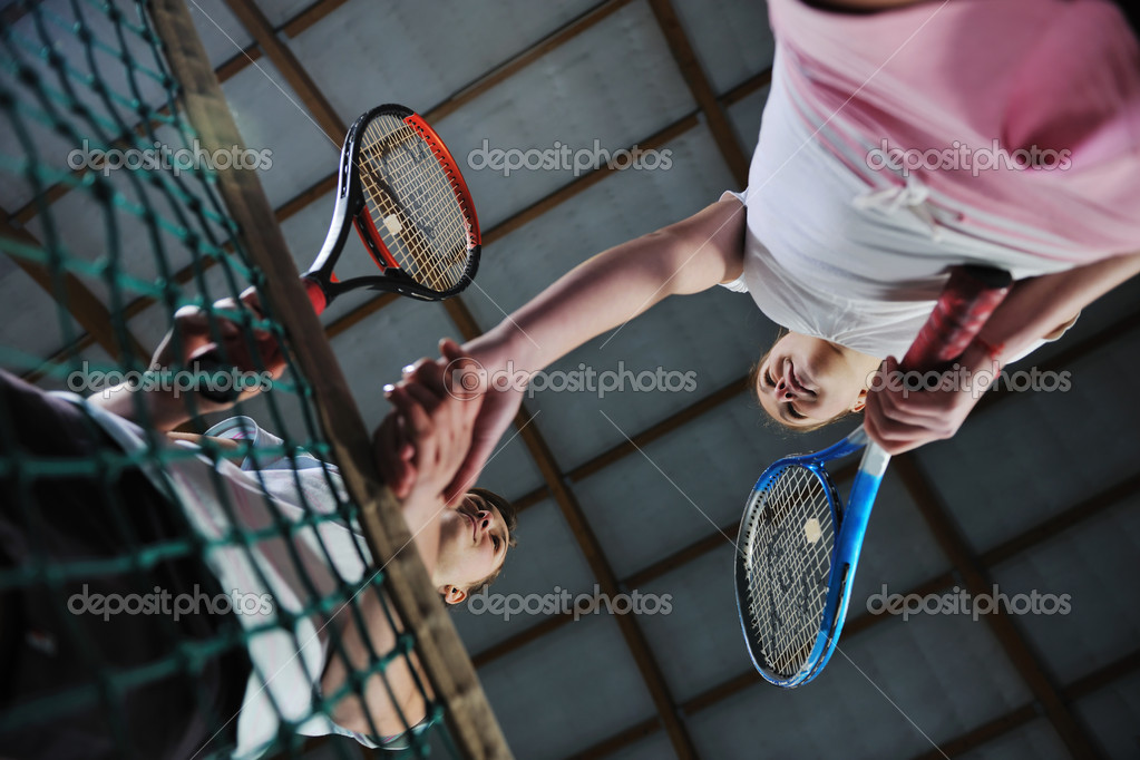 Young girls playing tennis game indoori in tennis court  Stock Photo #2513337