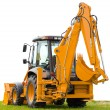 Backhoe on green grass — Stock Photo #1694940