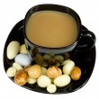 Cup of coffee with milk and candies — Stock Photo