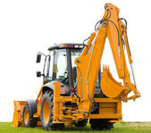 Backhoe on green grass — Stock Photo