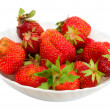 Many strawberries on plate — Stock Photo