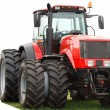 Stock Photo: New red tractor with double wheels