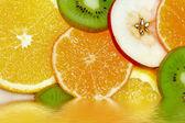 Fruits in water — Stok fotoğraf