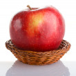 Red apple in basket with reflection — Stock Photo