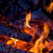 Close-up firewood in fire - Stock Photo