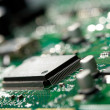 Microchip on green circuit board — Stock Photo #1799791