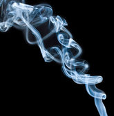Blue dense smoke on black — Stock Photo