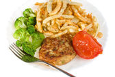 Cutlet with tomato broccoli and potatoes — Stock Photo