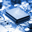 Stock Photo: Microchip on circuit board