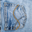 Old blue jeans hip pocket texture — Stock Photo