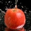 Red apple under water stream — Stock Photo #1816315
