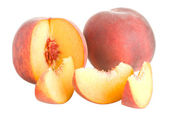 Peaches with slices — Stock Photo