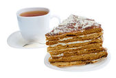 Piece of honey cake and tea cup — Stock Photo