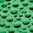Stock Photo: Water drops on plastic surface