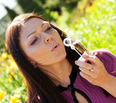Girl blow soap bubble — Stock Photo