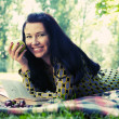 Beautiful young woman reading outdoor — Stock Photo