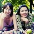 Two girls relaxing in park — Stock Photo #1670064