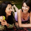 Stock Photo: Two girls relaxing in park