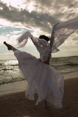 Woman dancing on the beach — Stock Photo