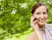 Woman using mobile phone outdoors — Stock Photo