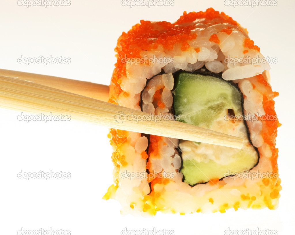 Sushi with chopsticks shot on white — Stock Photo #1670349