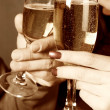 Young with champagne glasses - Foto Stock