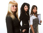 A business team lead by a business woman — Stock Photo