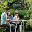Family in garden — Stock Photo