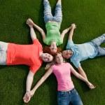 Friends lying on grass — Stock Photo