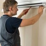 Man repair air-conditioner — Stock Photo #1817388