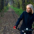 Stock Photo: Woman with bicycle