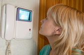 Woman using intercom — Stock Photo