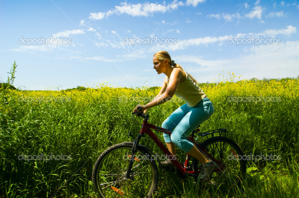 A girl relax biking in summer meadow — Stock Photo #1813121