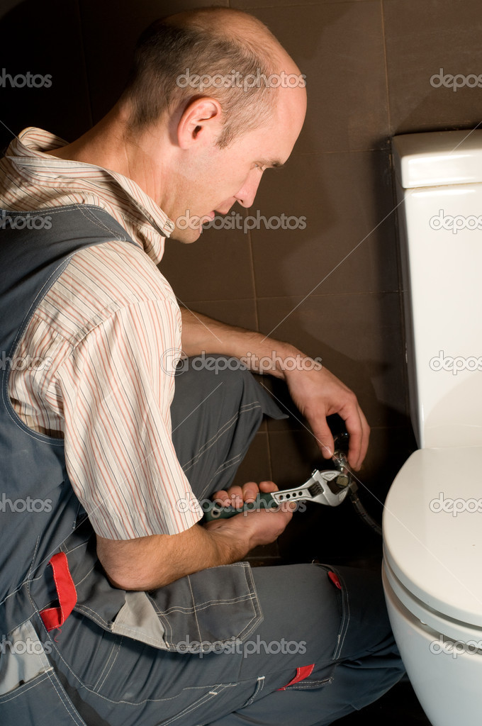 Plumber using a pipe wrench to repair a sink — Stock Photo #1816813