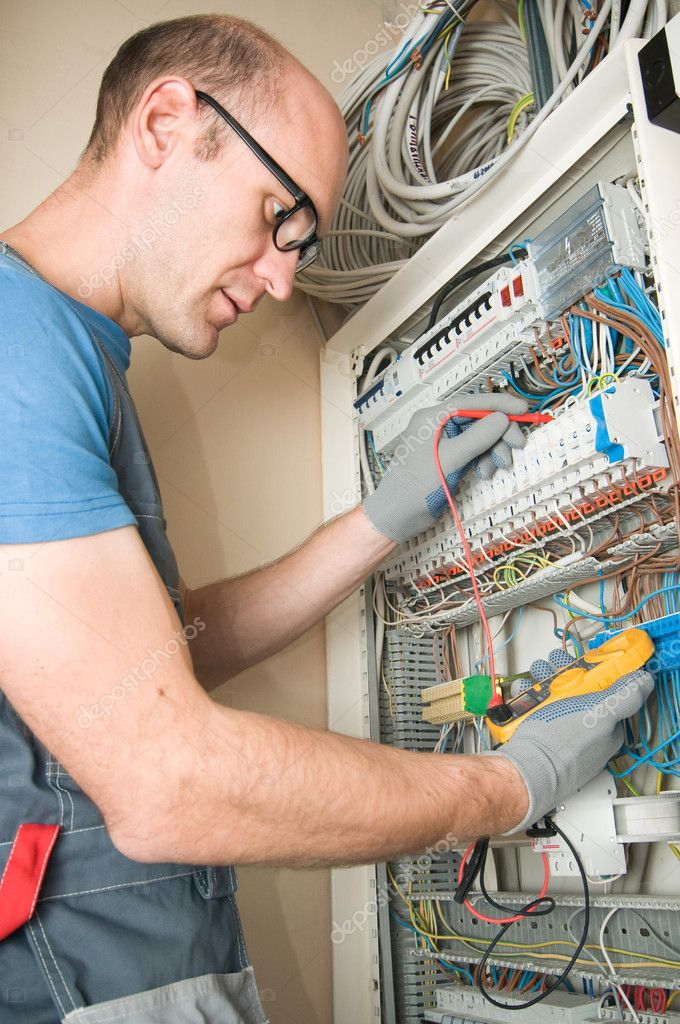 Electrician make connections in main electical panel  Stock Photo #1816863