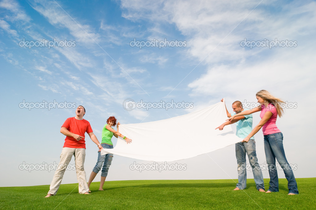 Casual group of students holding banner — Stock Photo #1817232