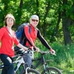 Couple biking — Stock Photo