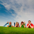 Friends lying on grass — Stock Photo
