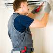 Man repair air-conditioner — Stock Photo