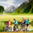 Cyclists biking outdoors - Stock Photo