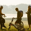 Cyclists at sunset - Stock Photo