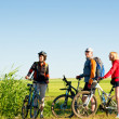 Cyclists relax biking outdoors - 