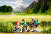 Cyclists biking outdoors — Stock Photo