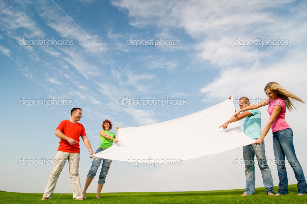 Casual group of students holding banner — Stock Photo #1820738